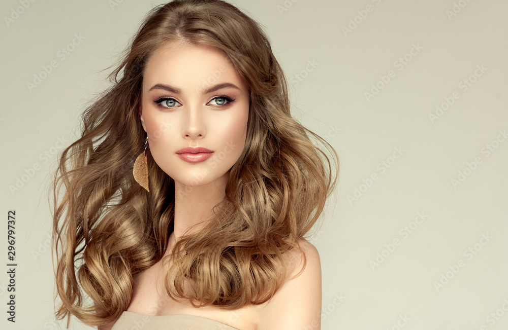 Fototapeta Beautiful model girl with elegant hairstyle and fashionable leaflet earrings . Woman with fashion  hair   and  accessories and jewelry ..