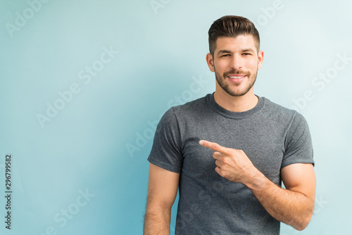Attractive Male Is Gesturing In Studio Canvas-taulu