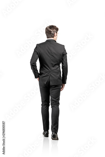 Fotografia Rear view of walking businessman, isolated