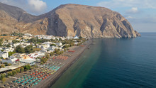 Aerial Drone Photo Of Famous Volcanic Beach And Bay Of Perissa Village, Santorini Island, Cyclades, Greece