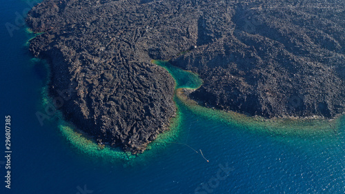 Foto auf Gartenposter Santorini Aerial drone top down photo of iconic main Crater of Santorini volcanic island called Kameni visited by tourist boats, Cyclades, Greece