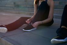 Woman Tying Her Running Shoe Lace