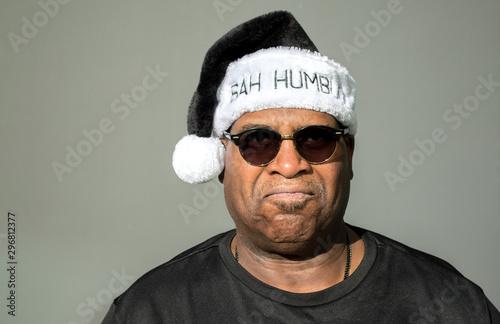 grumpy African American man wearing sunglasses and a black and white Bah Humbug Billede på lærred