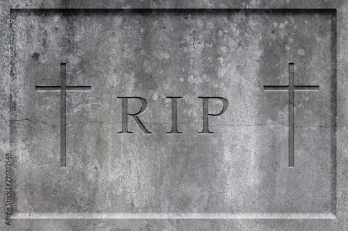 Fotomural Old gray stone headstone with carved text R.I.P. and two crosses