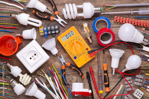 Платно Electrician equipment on wooden background,  top view