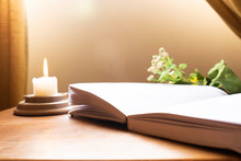 Book, Plants And Candle