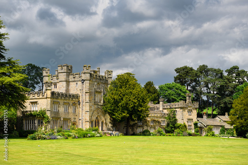 Photo Bolton Abbey Hall original gatehouse to Bolton Priory in sun with clouds Bolton