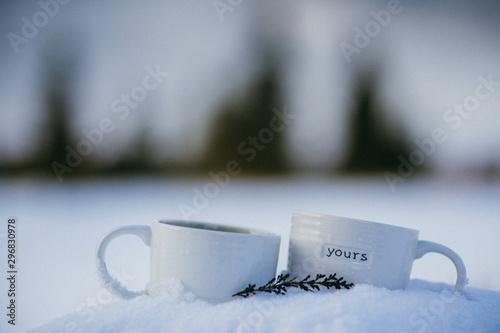 Foto op Canvas Bleke violet Hot drink cups in snow with inscription 'Yours'. Cozy Christmas concept.