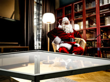 Santa Claus Resting In A Living Room After Delivering Prtesents. Comfortable And Cozy Place In Home Interior.