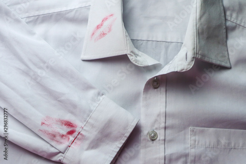 Fotografiet Dirty lipstick stain on white shirt. Stain remover concept