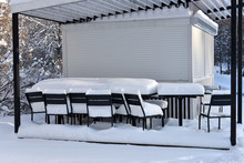 Snow-covered Veranda Of Summer Cafe In The Winter.