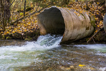Perched And Undersized Culverts Block Fish Migration In River In Forest