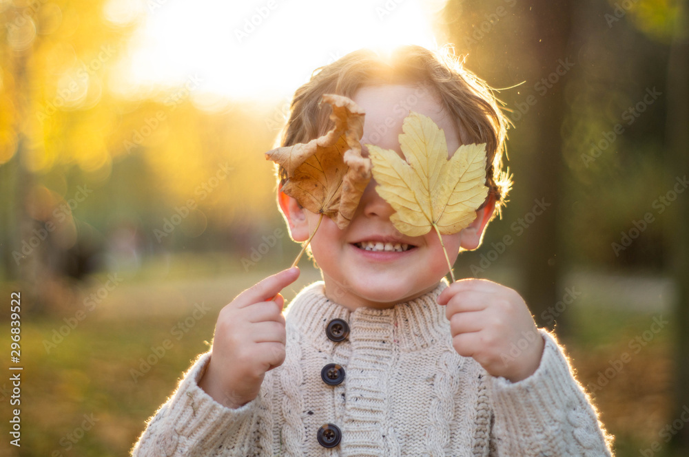 Fototapety, obrazy: Happy little child baby boy laughing and playing in the autumn