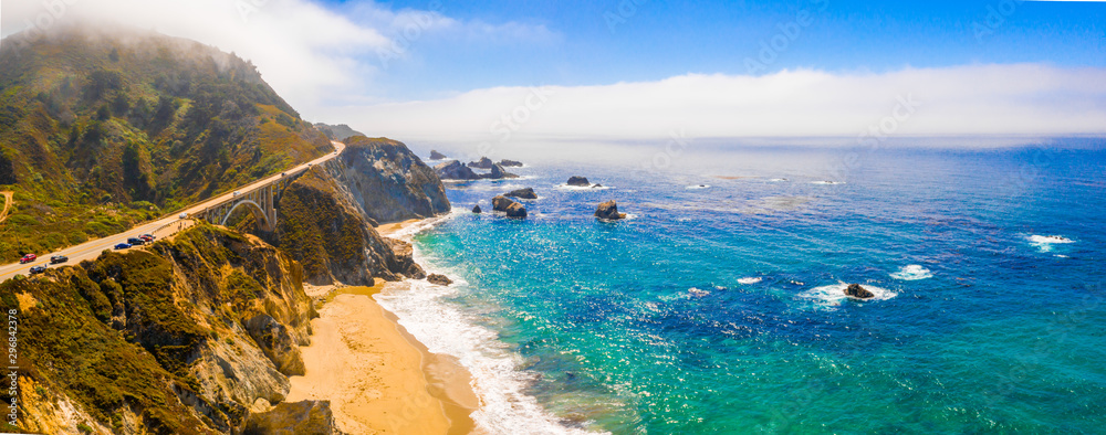 Magical aerial view of the route 101 by the Californian Pacific Coast on the way from Los Angeles to San Francisco near Big Sur Bixby Bridge.