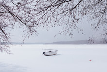 View Of Boat On Frozen Lake