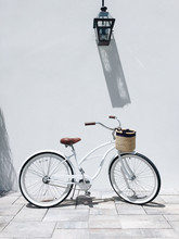 White Bicycle Parked In Street