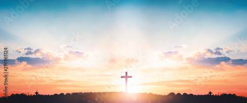 Resurrection of Jesus Christ concept: God Lamb in front of the cross of Jesus Christ on sunrise background