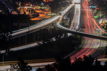 Fototapeta na wymiar Night view of commuters on Route 134 and Interstate 5 Freeway interchange ramps near Los Angeles, Burbank and Glendale, California.