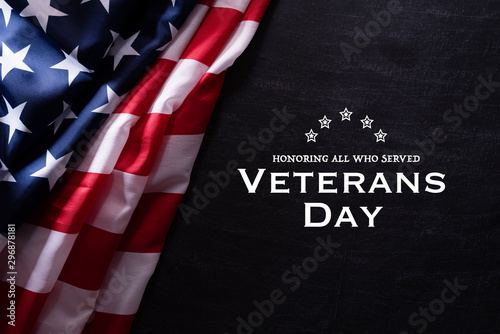 Fototapeta Happy Veterans Day. American flags veterans against a blackboard background. obraz