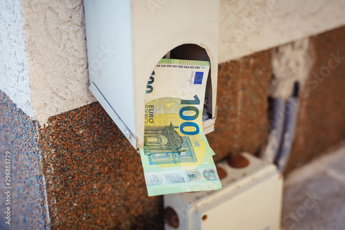 Fotografie, Tablou  Hundredth euro banknotes in drainpipe. Business concept
