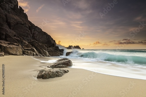Bright sunny day at the sandy shore of the ocean in Porthcurno, Cornwall, UK Wallpaper Mural