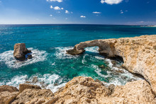 The Bridge Of Lovers Or Monk Seal Arch, Stone Cliffs In The Mediterranean Sea In Ayia NAPA Cyprus.