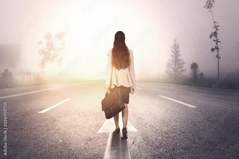 Fototapety, obrazy: Rear view of businesswoman walking on misty road