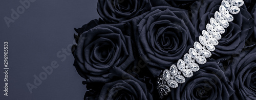 Foto auf Gartenposter Roses Luxury diamond jewelry bracelet and black roses flowers, love gift on Valentines Day and jewellery brand holiday background design