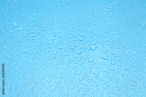Fototapeta  Close up water drops on blue background, Water drop in macro photography
