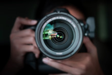 Photographer  Take Pictures Snapshot With Camera. Man Hand Holding With Camera Looking Through Lens.Concept For Photographing Articles Professionally.