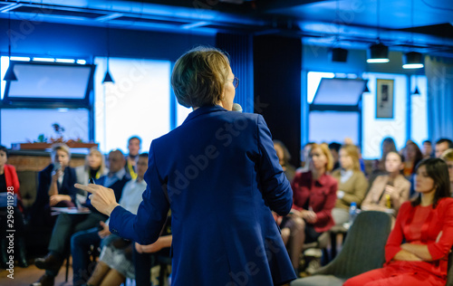 Recess Fitting Amsterdam Female presenter speaks to audiences