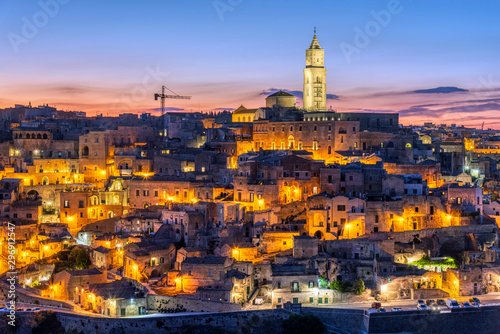 Tuinposter Oude gebouw The old town of Matera in southern Italy after sunset