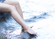 Woman Legs Relaxing With Water...