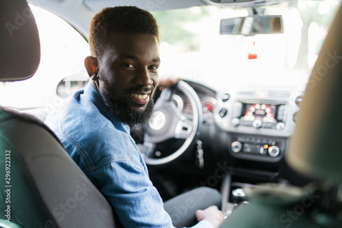 Young african american man driving a car Tableau sur Toile