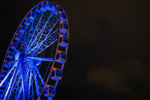 Picture Of Ferris Wheel Against Background Of Night Sky