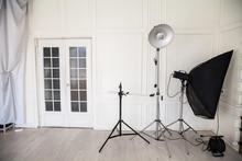 White Photo Studio Interior With Flashes And Racks