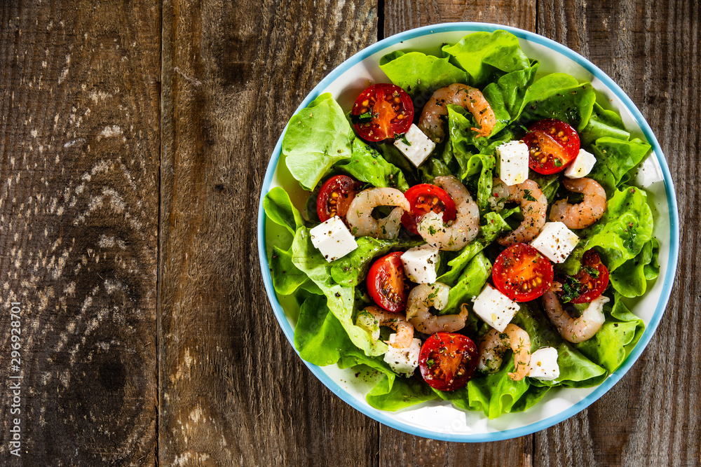 Fototapety, obrazy: Salad with shrimps and feta cheese on wooden table