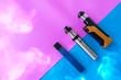 canvas print picture - e cigarette tank vs pod in blue and pink background