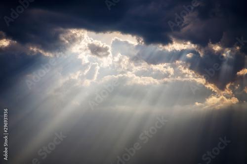 a beam of sunlight breaks through a dense cloud Tapéta, Fotótapéta