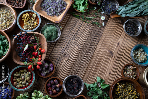 Obraz Set of colorful spices in different bowls on wooden table - fototapety do salonu