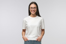 Young Smiling Woman Standing W...