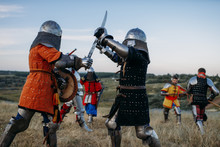 Knights In Armour And Helmets Fight With Swords