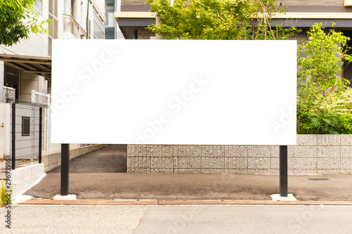 Large blank billboard on a street wall, banners with room to add your own text Fototapete