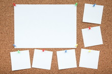 A Sheets Of Paper Are Attached To The Cork Board With A Push-buttons. Empty Note Papers Pinned On Corkboard