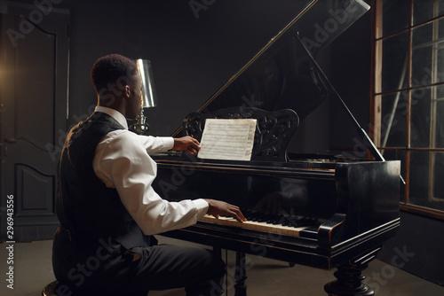 Fototapeta Ebony pianist, jazz performer on the stage