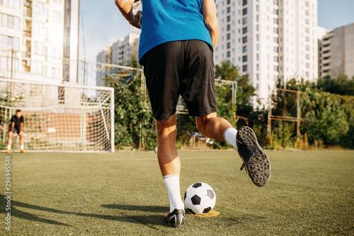 Obraz na płótnie Male soccer player hits the ball on the field