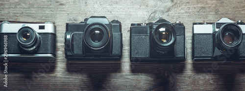 Pinturas sobre lienzo  Collection of unrecognizable film cameras on a wooden surface