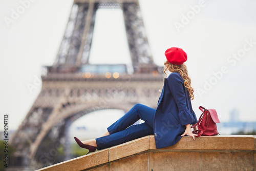 Obraz Young woman with long blond curly hair in Paris, France - fototapety do salonu