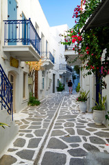 Beautiful romantic narrow backstreet alley lane with typical traditional whitewashed Greek houses in Parikia on the Cyclade Island of Paros