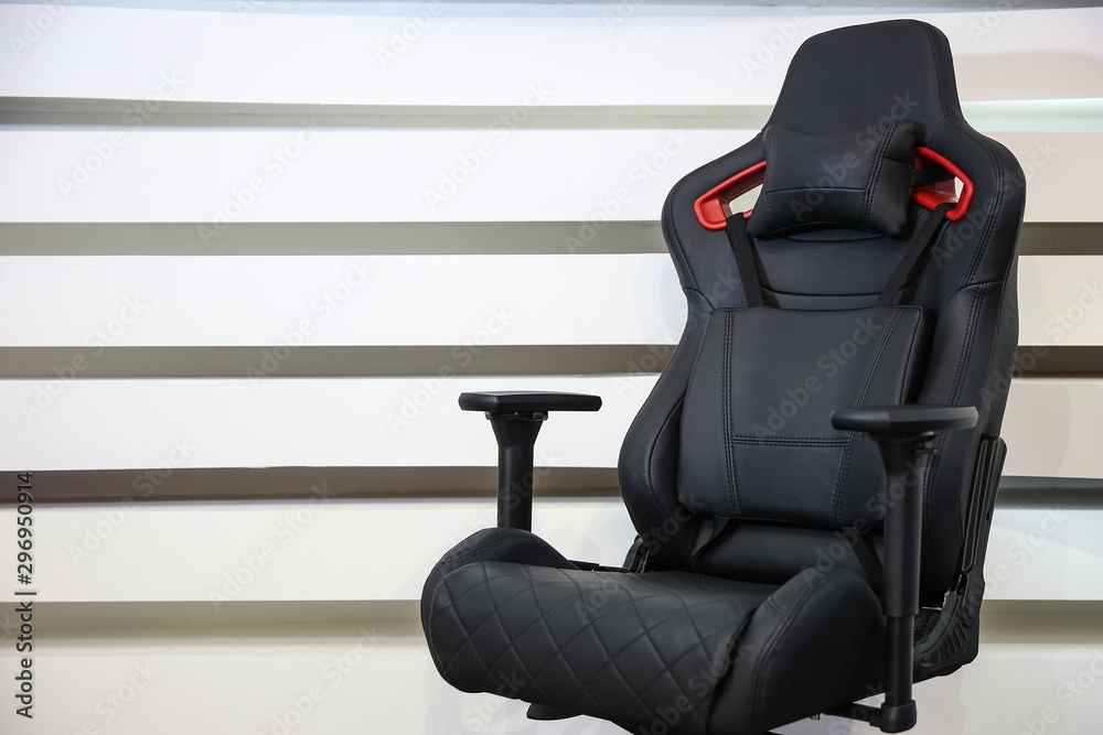 Fototapeta computer gaming chair on a striped background with copy space